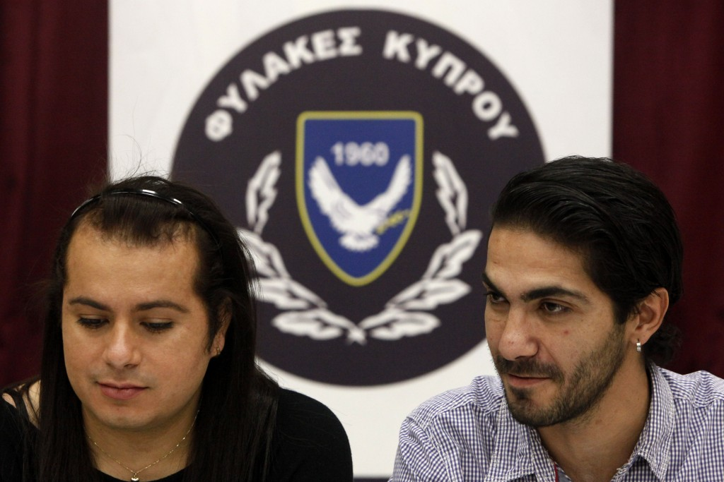 Cypriot Kevork Tontian, right, and Brazilian Wemson Gabral da Costa talk during an interview inside Cyprus' prison complex in capital Nicosia, Cyprus,...