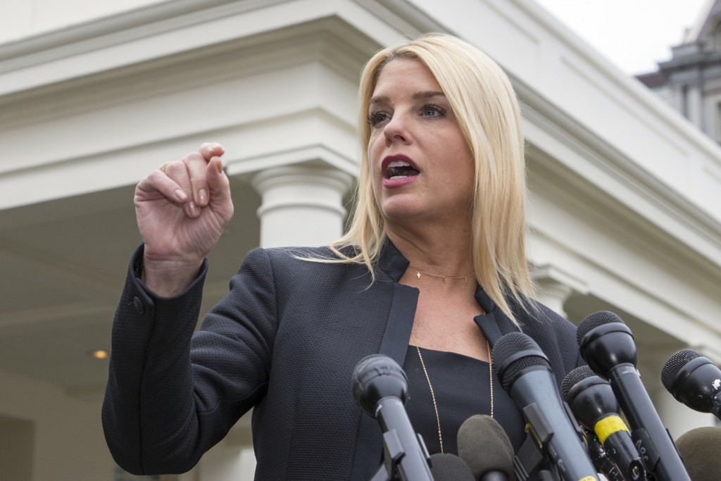 FILE - In this Feb. 22, 2018 file photo, Florida Attorney General Pam Bondi, speaks to reporters outside the West Wing in Washington.  President Donal...