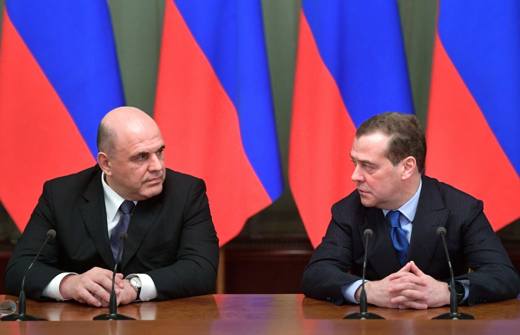 FILE - In this file photo taken on Jan. 17, 2020, New Russian Prime Minister Mikhail Mishustin, left, and former Prime Minister, Deputy Chairman of th...