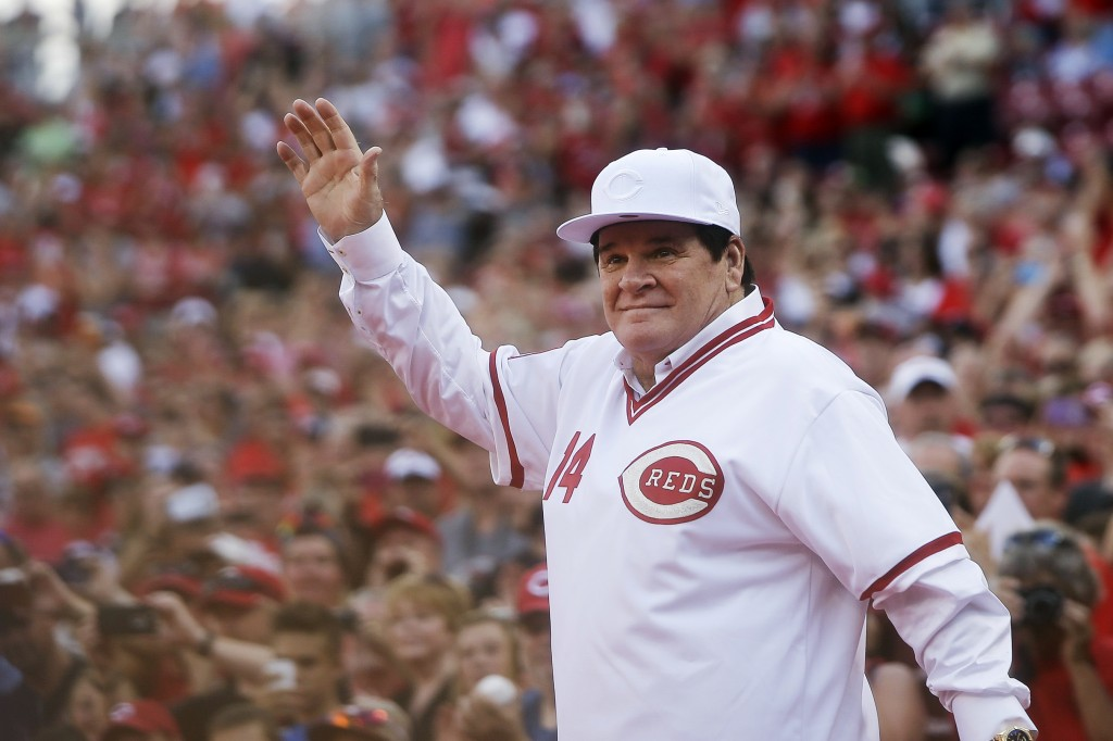 FILE - In this June 24, 2016, file photo, former Cincinnati Red Pete Rose waves to the crowd as he is introduced on the field during a ceremony to hon...