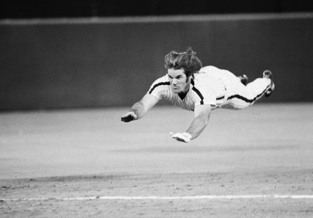 FILE - In this June 3, 1981 file photo, Philadelphia Phillies' Pete Rose slides to third base during a baseball game against the New York Mets in Phil...
