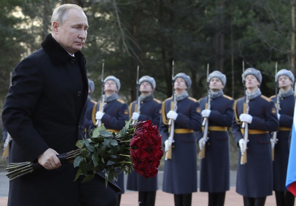 President Vladimir Putin attends a wreath laying commemoration ceremony for the 77th anniversary since the Leningrad siege was lifted during the World...