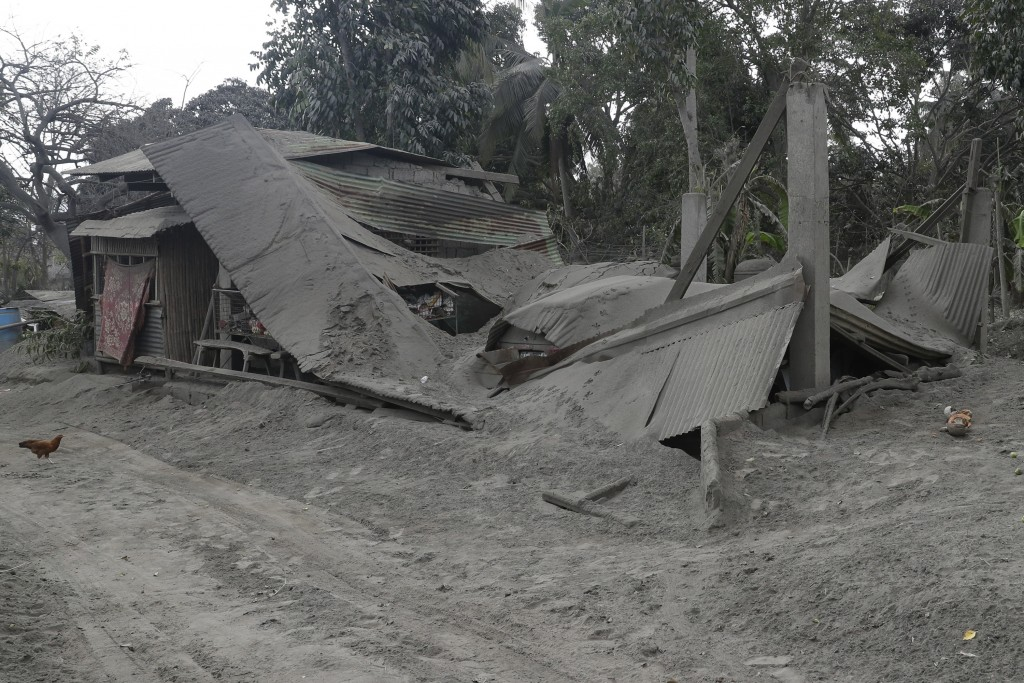 A damaged house lies at a lakeshore village beside Taal volcano where residents have evacuated to safer ground in Agoncillo, Batangas province, southe...
