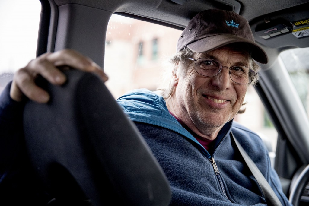 Bruce Bock, 68, a truck driver, poses for a photograph following an interview with the Associate Press, Wednesday, Jan. 15, 2020, in Iowa City, Iowa. ...