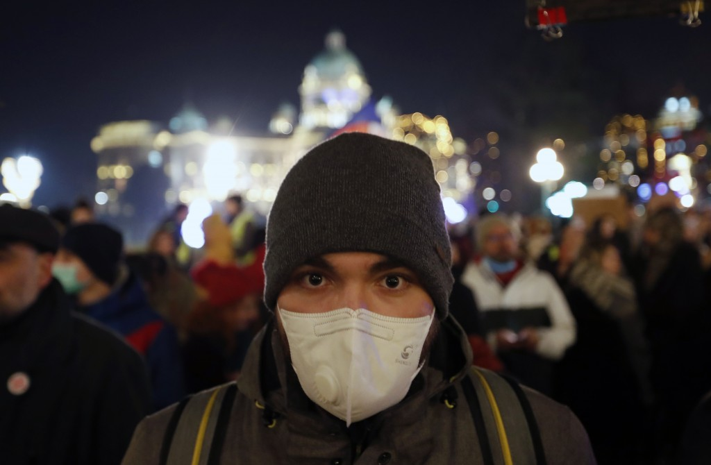 A man wearing a face mask attends during a protest against the high levels of air pollution in Belgrade, Serbia, Friday, Jan. 17, 2020. Cities through...
