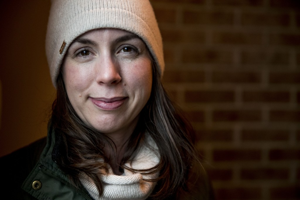 Amanda West, 38, a stay at home mother, poses for a photograph following an interview with the Associate Press, Wednesday, Jan. 15, 2020, in Iowa City...