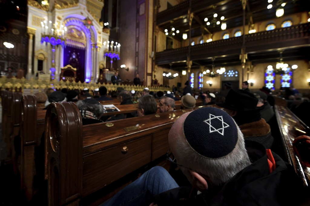 People attend a ceremony that commemorates the 75th anniversary of the liberation of the Budapest Jewish ghetto in Dohany Street Synagogue in Budapest...