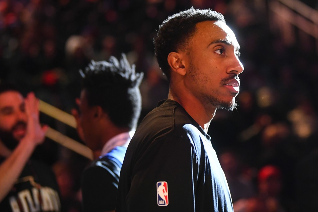 Atlanta Hawks guard Jeff Teague looks on as teammates are introduced before an NBA basketball game against the Detroit Pistons, Saturday, Jan. 18, 202...
