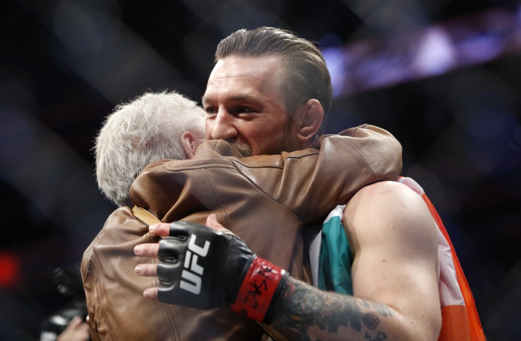 """Conor McGregor, right, embraces Jerry Cerrone, the grandmother of Donald """"Cowboy"""" Cerrone, after a UFC 246 welterweight mixed martial arts bout, Satur..."""