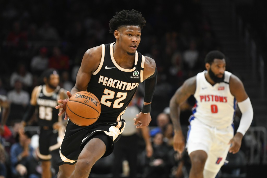 Atlanta Hawks forward Cam Reddish (22) brings a stolen ball upcourt during the first half of an NBA basketball game against the Detroit Pistons, Satur...
