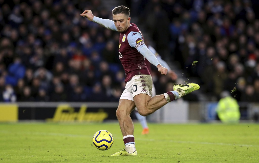 Aston Villa's Jack Grealish scores his side's first goal of the game during the English Premier League soccer match between Brighton and Hove Albion a...