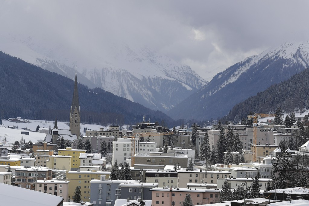 Snow covers the hills around Davos, Switzerland, Sunday, Jan. 19, 2020. The city will host the 50th annual meeting of the World Economic Forum from Ja...