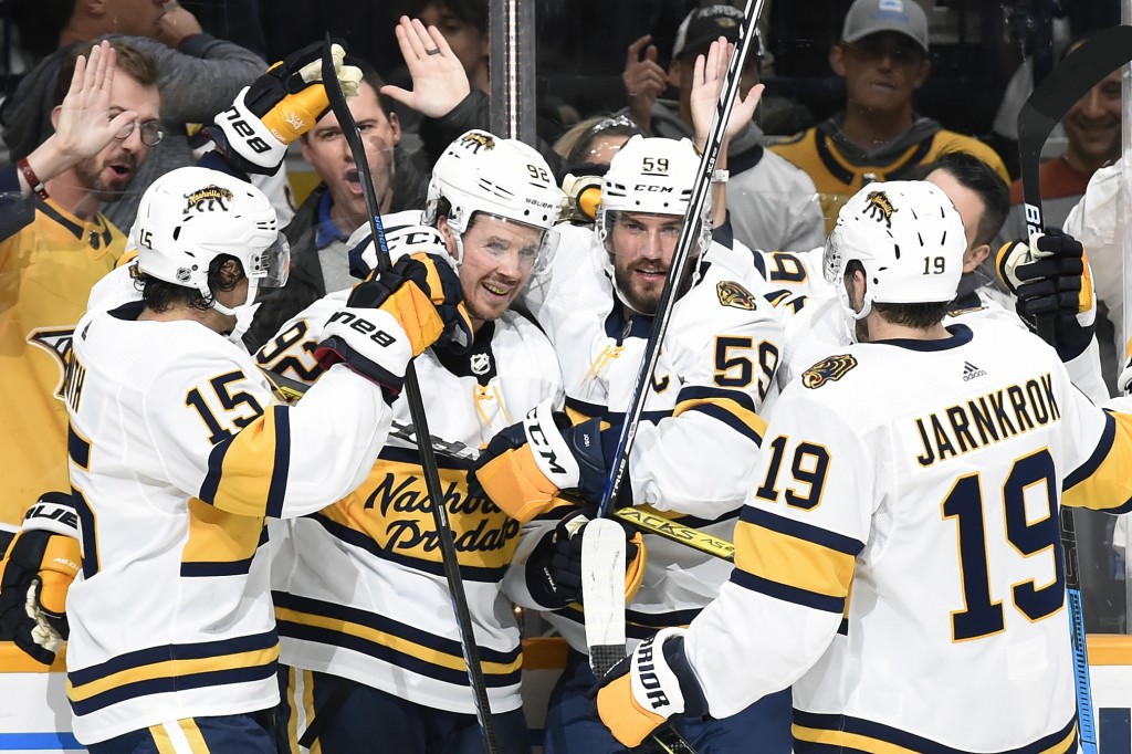 Nashville Predators center Ryan Johansen (92) is congratulated by teammates after scoring against the Buffalo Sabres during the second period of an NH...