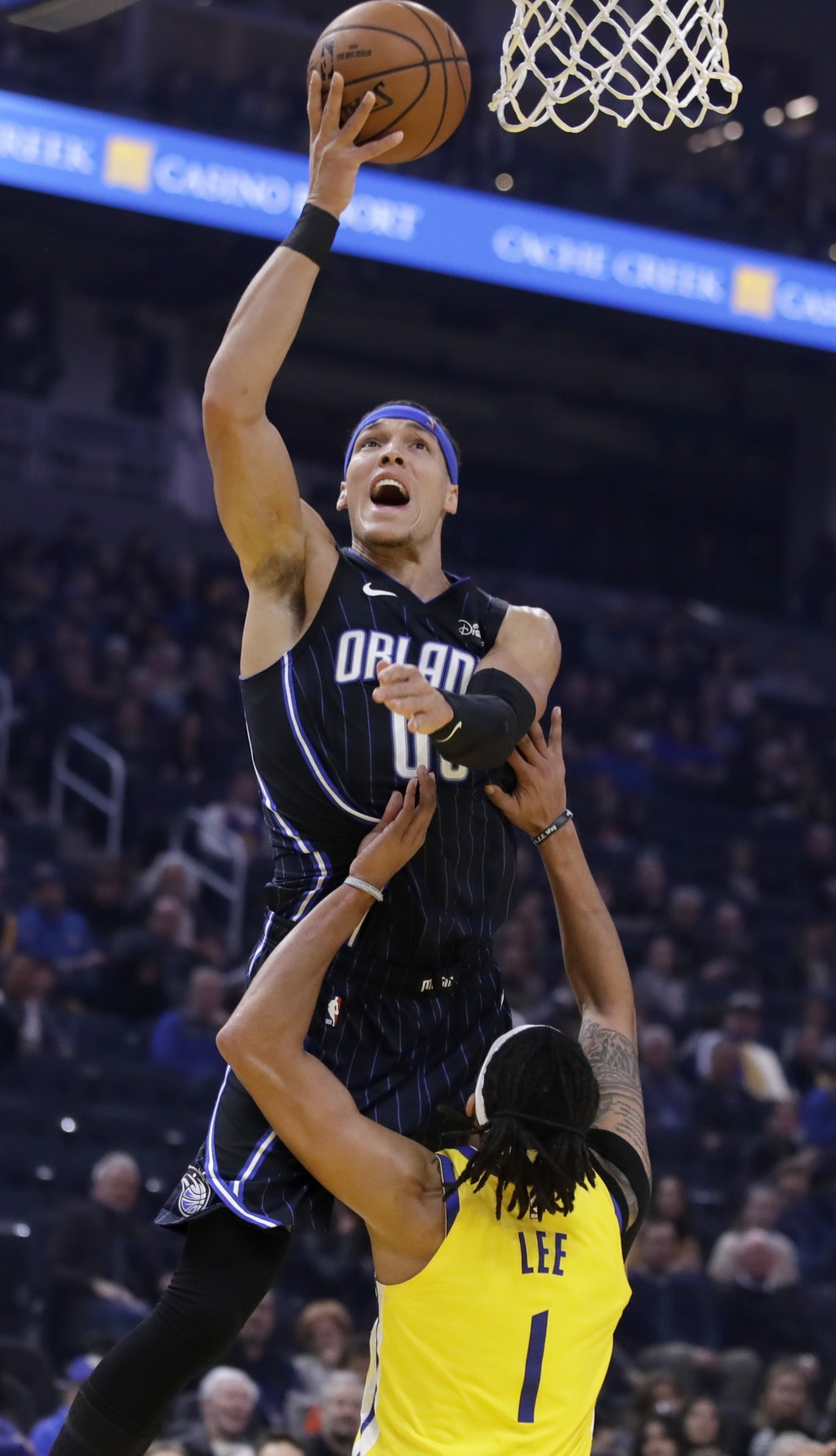 Orlando Magic's Aaron Gordon shoots over Golden State Warriors' Damion Lee (1) in the first half of an NBA basketball game Saturday, Jan. 18, 2020, in...