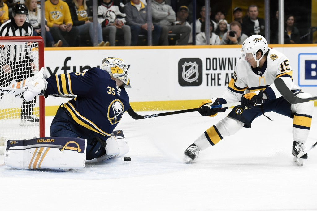 Buffalo Sabres goaltender Linus Ullmark (35), of Sweden, blocks a shot by Nashville Predators right wing Craig Smith (15) during the second period of ...