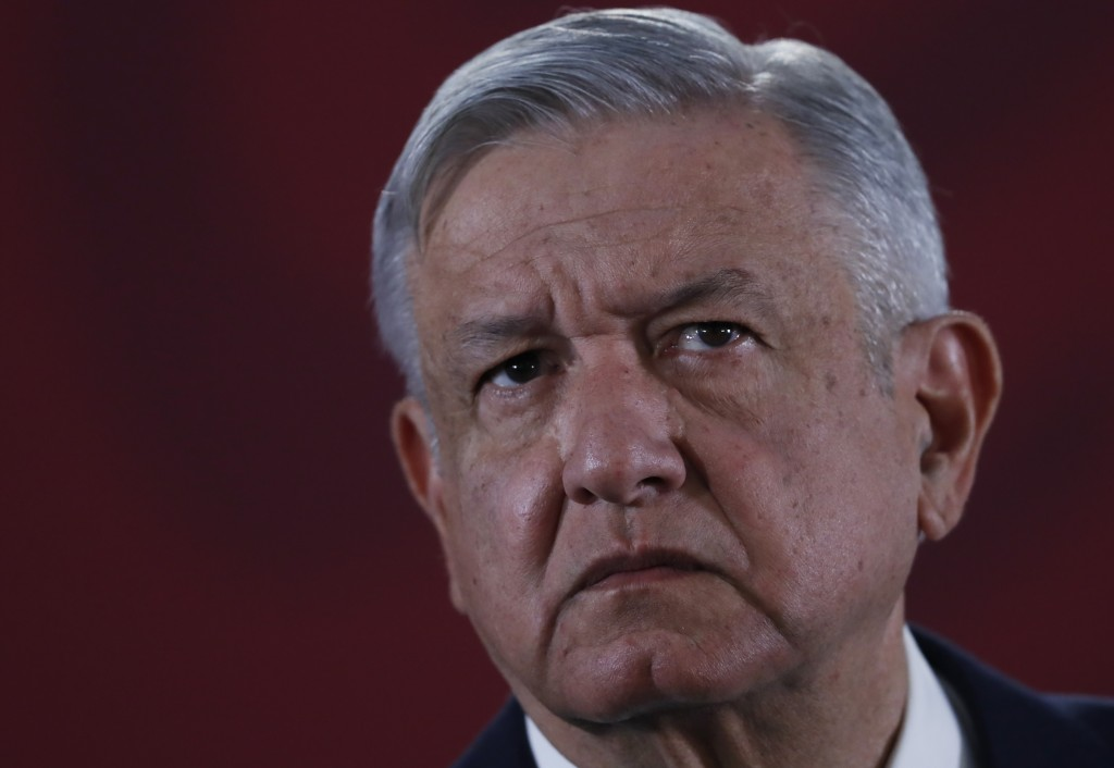 FILE - In this Nov. 29, 2019 file photo, Mexican President Andres Manuel Lopez Obrador listens to questions during his daily morning press conference ...