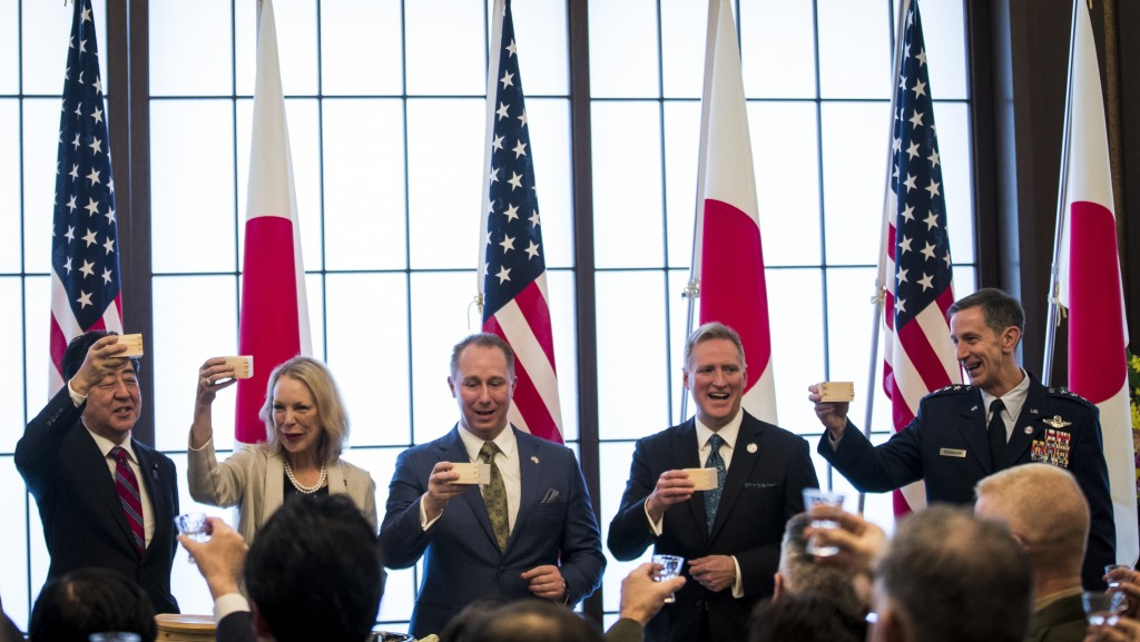 From left; Japan's Prime Minister Shinzo Abe, granddaughter Mary Jean Eisenhower and the great grandson Merrill Eisenhower Atwater of former U.S. Pres...
