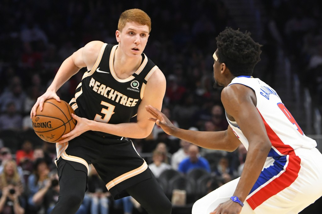 Atlanta Hawks guard Kevin Huerter (3) is defended by Detroit Pistons guard Langston Galloway during the first half of an NBA basketball game Saturday,...