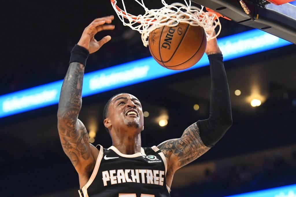 Atlanta Hawks forward John Collins dunks against the Detroit Pistons during the first half of an NBA basketball game Saturday, Jan. 18, 2020, in Atlan...
