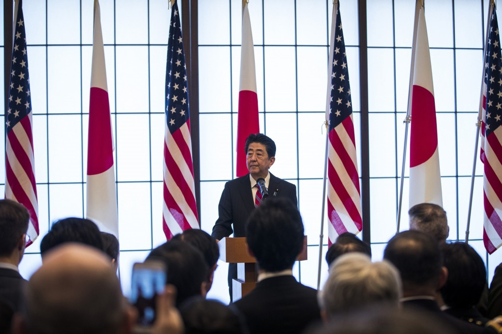 Japan's Prime Minister Shinzo Abe delivers his speech during the 60th anniversary commemorative reception of the signing of the Japan-US security trea...