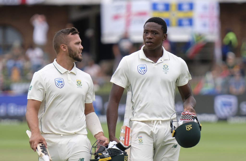 Dane Paterson of South Africa left and Kagiso Rabada, right, of South Africa leave the field afte rSouth Africa get bowled out during day four of the ...