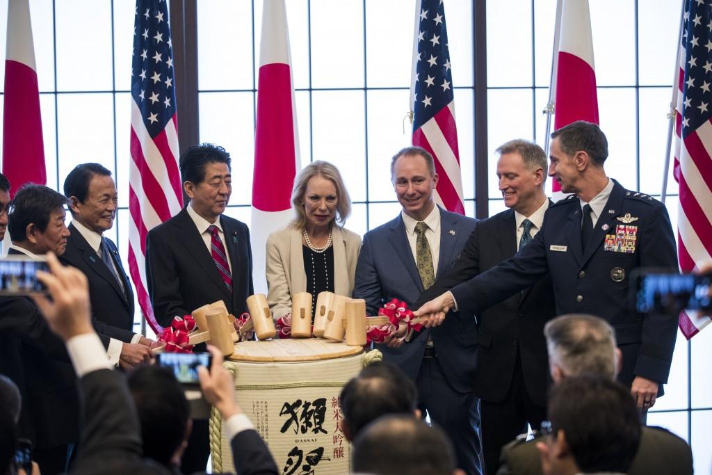 From left; Japan's Foreign Minister Toshimitsu Motegi, deputy prime minister Taro Aso, Prime Minister Shinzo Abe, granddaughter Mary Jean Eisenhower a...