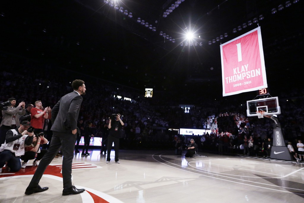 Golden State Warriors and former Washington State guard Klay Thompson watches as the school retires and lifts his jersey number to the rafters during ...