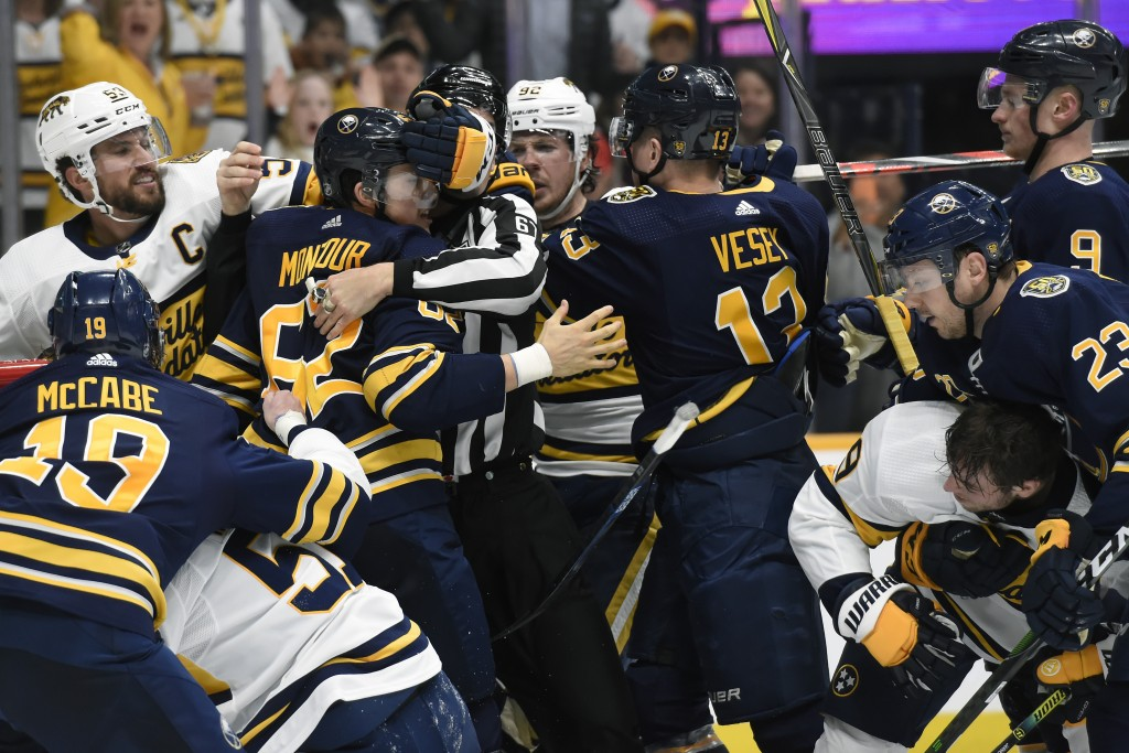 The Nashville Predators and Buffalo Sabres fight during the second period of an NHL hockey game Saturday, Jan. 18, 2020, in Nashville, Tenn. (AP Photo...