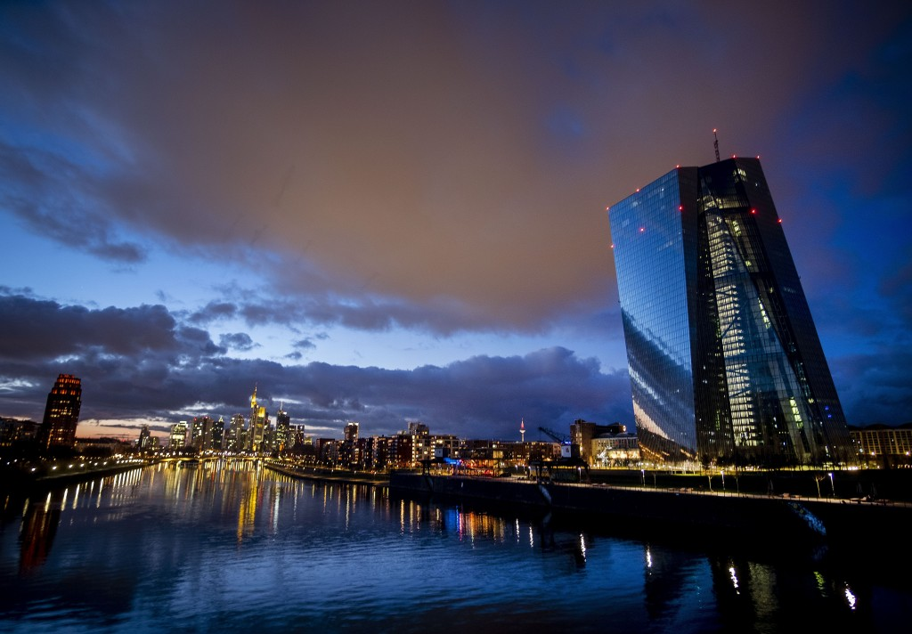 Clouds drift over the European Central Bank, right, in Frankfurt, Germany, Saturday, Jan. 18, 2020. (AP Photo/Michael Probst)