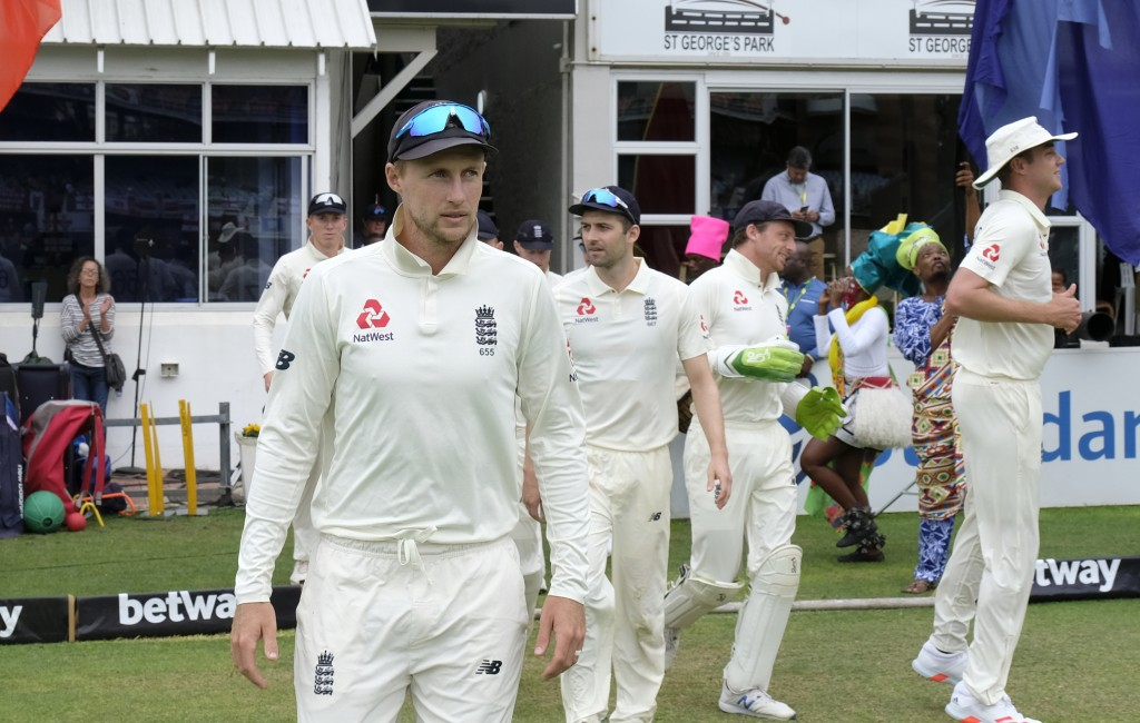 Joe Root (C) batsman of England leads the team onto the field during day four of the third cricket test between South Africa and England in Port Eliza...