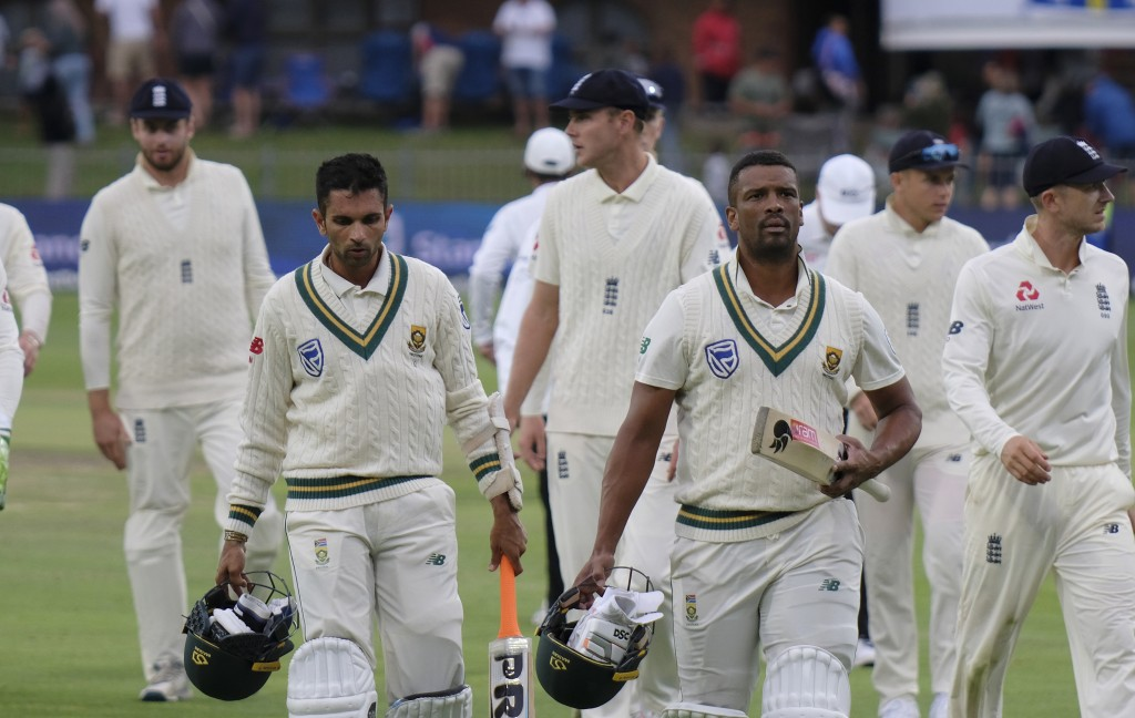 Keshav Maharaj, left, and Vernon Philander of South Africa, leave the field during day four of the third cricket test between South Africa and England...