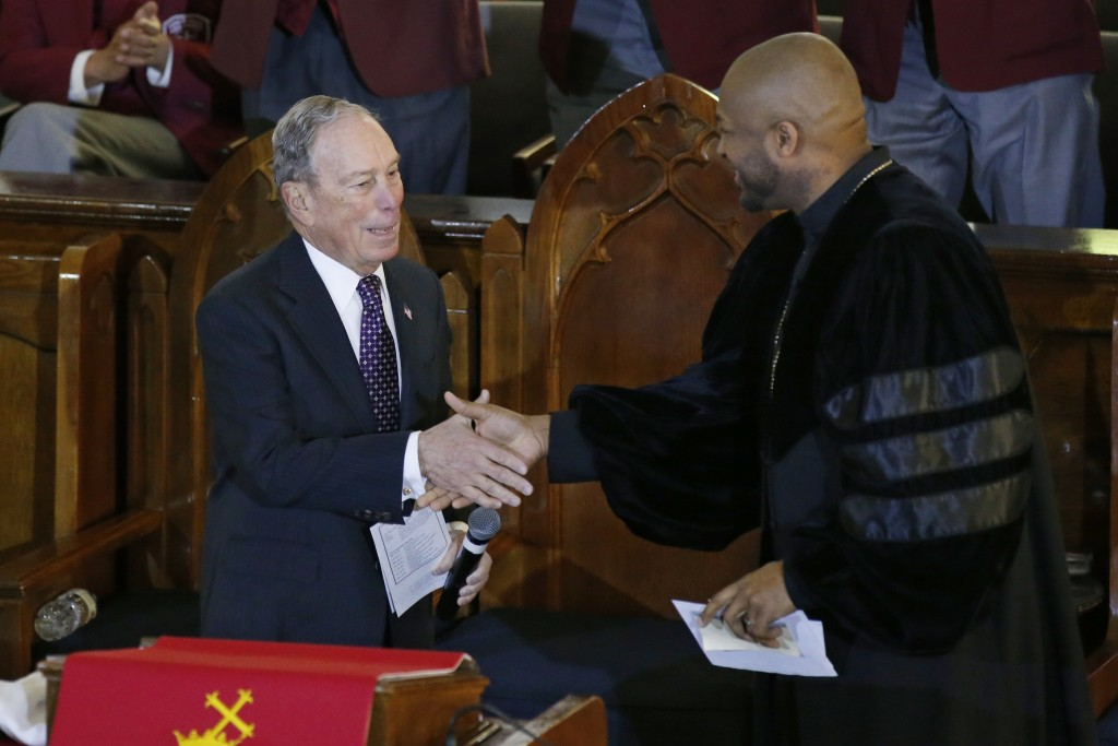 Democratic Presidential candidate Michael Bloomberg, left, greets the Rev. Robert Turner, right, during a service at the Vernon American Methodist Epi...