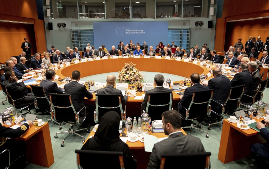 German Chancellor Angela Merkel, rear center, leads a conference on Libya at the chancellery in Berlin, Germany, Sunday, Jan. 19, 2020. (Kay Nietfeld/...