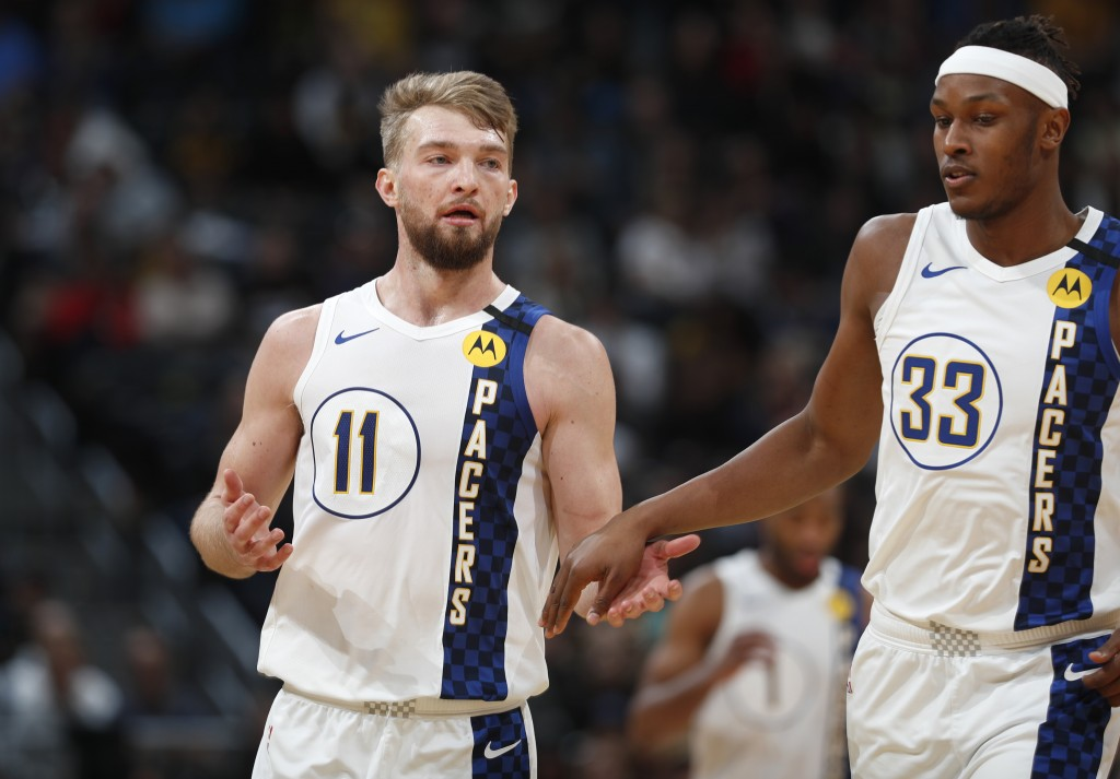Indiana Pacers center Myles Turner, right, congratulates Indiana Pacers forward Domantas Sabonis after he hit a key basket late in the second half of ...