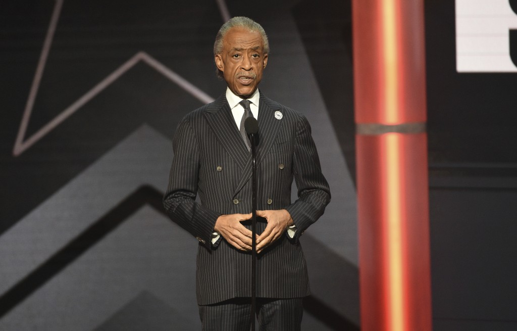 FILE - This June 23, 2019 file photo shows Al Sharpton presenting an award at the BET Awards in Los Angeles. Sharpton is working on a book meant to ad...