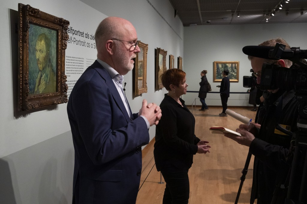 Van Gogh Museum senior researcher Louis van Tilborgh, left, and Norway's National Museum curator Mai Britt Guleng, center, talk about the previously c...