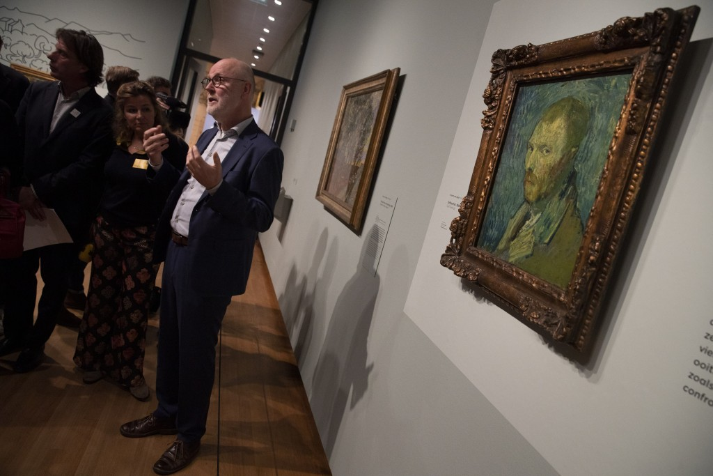 Van Gogh Museum's senior researcher Louis van Tilborgh gestures as he talks to journalists about the previously contested painting by Dutch master Vin...
