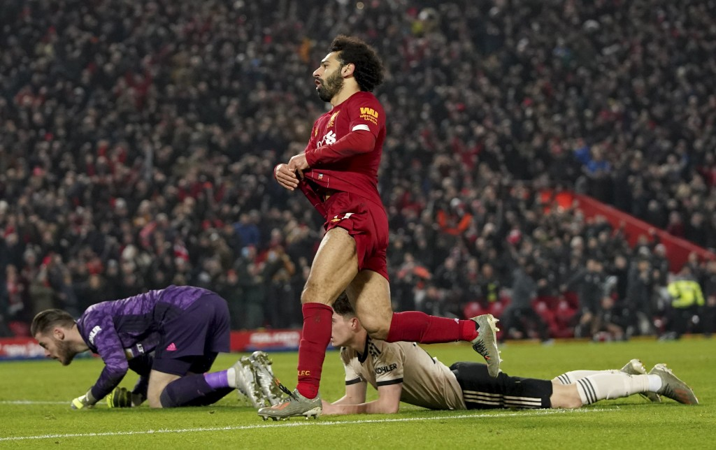 Liverpool's Mohamed Salah, centre, celebrates after scoring his side's second goal during the English Premier League soccer match between Liverpool an...