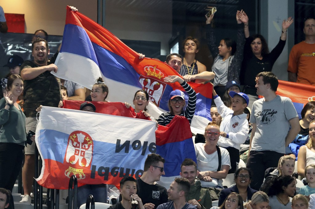 Supporters of Serbia's Novak Djokovic cheer him on during his first round match against Germany's Jan-Lennard Struff at the Australian Open tennis cha...