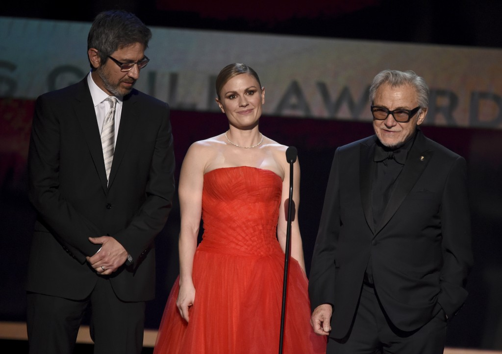 "Ray Romano, from left, Anna Paquin, and Harvey Keitel introduce a clip from ""The Irishman"" at the 26th annual Screen Actors Guild Awards at the Shrine..."
