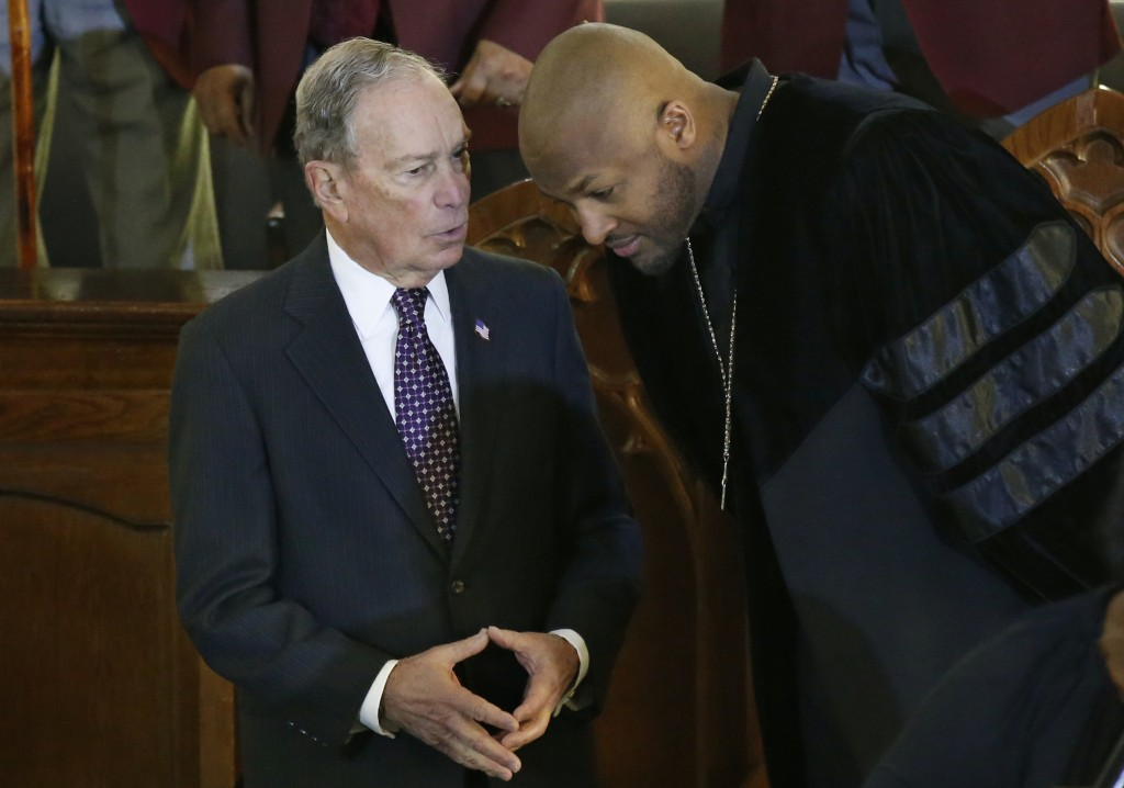 Democratic Presidential candidate Michael Bloomberg, left, talks with the Rev. Robert Turner, right, during a service at the Vernon American Methodist...