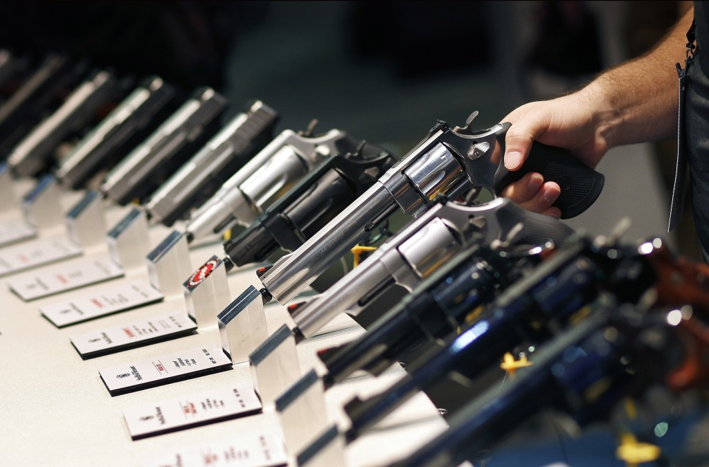 FILE - In this Jan. 19, 2016, file photo, handguns are displayed at the Smith & Wesson booth at the Shooting, Hunting and Outdoor Trade Show in Las Ve...