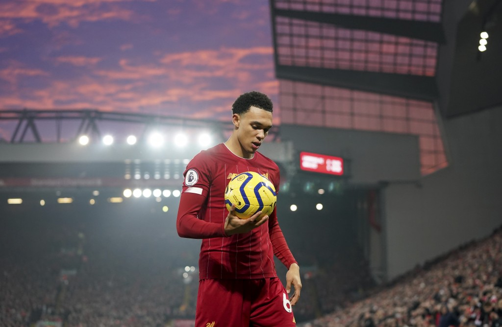 Liverpool's Trent Alexander-Arnold holds the ball during the English Premier League soccer match between Liverpool and Manchester United at Anfield St...