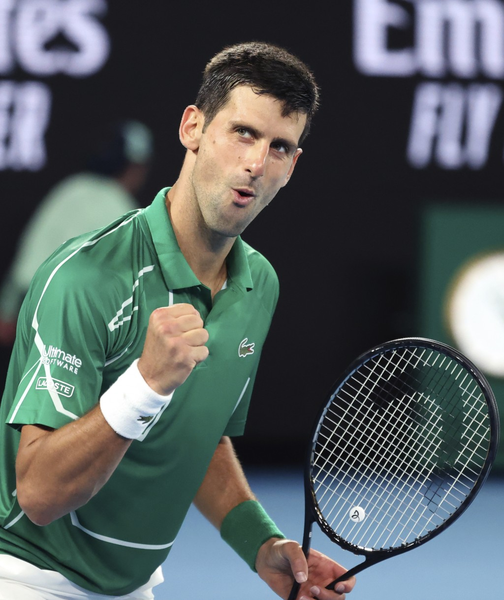 Serbia's Novak Djokovic reacts after winning a point against Germany's Jan-Lennard Struff at the Australian Open tennis championship in Melbourne, Aus...