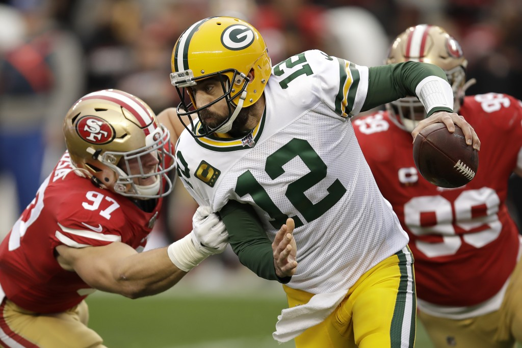Green Bay Packers quarterback Aaron Rodgers (12) is sacked by San Francisco 49ers defensive end Nick Bosa (97) during the first half of the NFL NFC Ch...