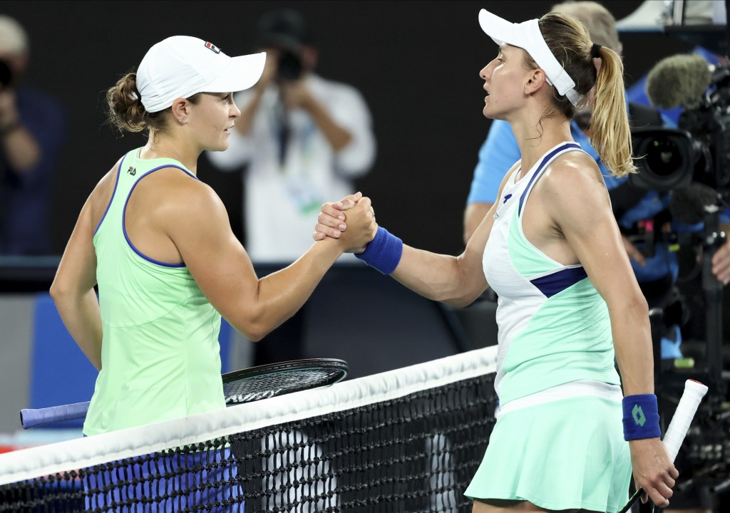 Australia's Ashleigh Barty, left, is congratulated by Lesia Tsurenko of Ukraine after winning their first round singles match at the Australian Open t...