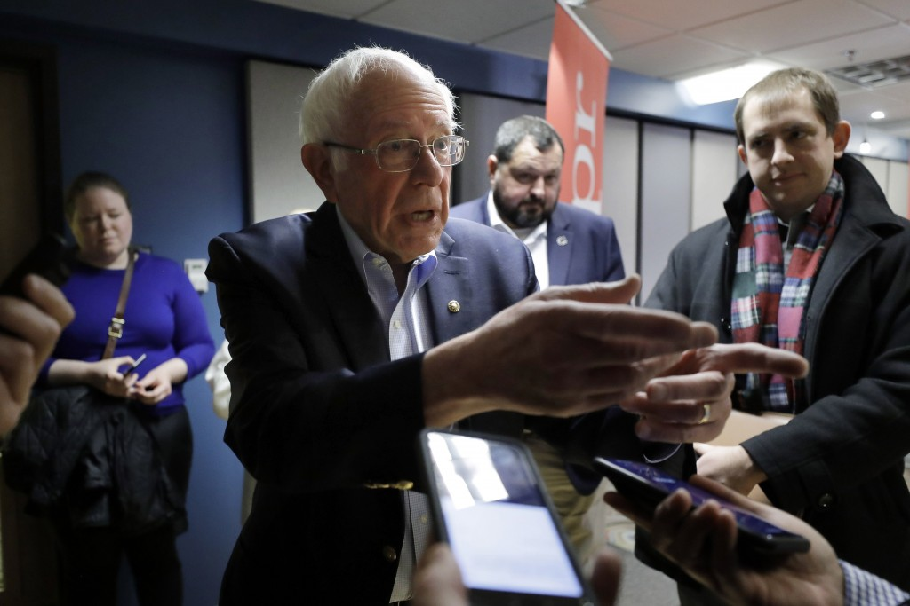 Democratic presidential candidate Sen. Bernie Sanders, I-Vt., speaks with reporters following a forum broadcast on radio in a New Hampshire Public Rad...