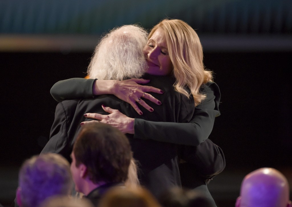 "Laura Dern, right, hugs Bruce Dern before going on stage to accept the award for outstanding performance by a female actor in a supporting role for ""M..."