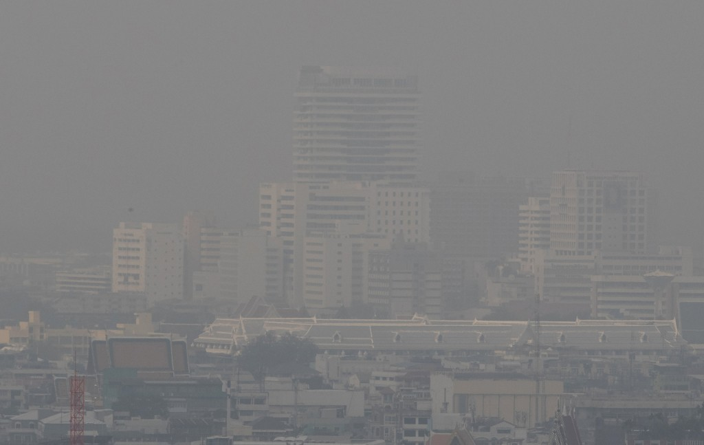 A thick layer of smog covers central Bangkok, Thailand, Monday, Jan. 20, 2020. Thick haze blanketed the Thai capital on Monday sending air pollution l...