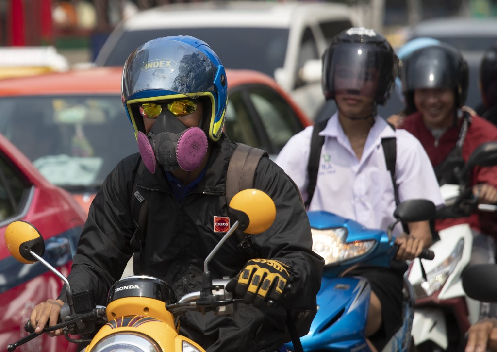 Motorcyclists wear face masks to protect from the poor air quality Bangkok, Thailand, Monday, Jan. 20, 2020. Thick haze blanketed the Thai capital on ...